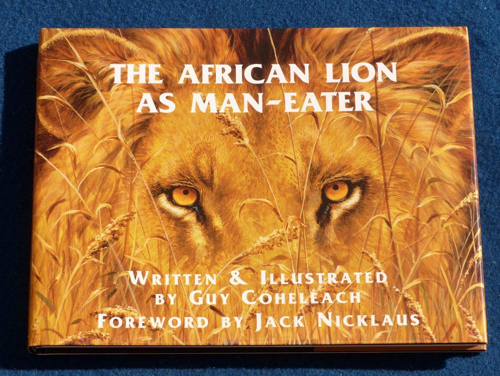 """The African Lion as Maneater"" <br><font size=4><I>Book by Guy Coheleach with foreword by Jack Nicklaus</I></font><BR><BR><table align=""center"" width=""100%""><TR><TD align=""center""><B>Deluxe Edition<br>$115.00</B><TD align=""center""><B>Trade Edition<br>$55.00</B></TD></TR></table> African Lion as Maneater  Coffee Table Books  Collectable Plates"
